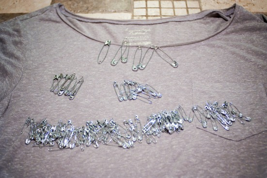 Safety pin and ripped t-shirt diy